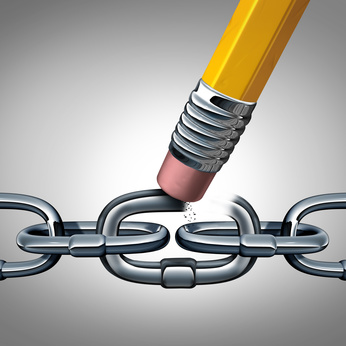 Concept of weakness and broken chain as a business symbol with metal links and a pencil eraser erasing a key connection as a metaphor for disconnecting or divorce with 3D Illustration elements.