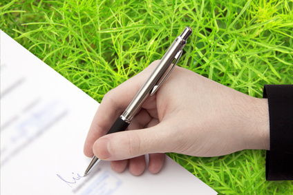 The Signature of Business Contract on the green Background