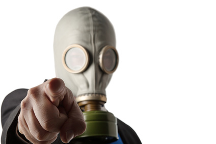 business man wearing a old gas mask
