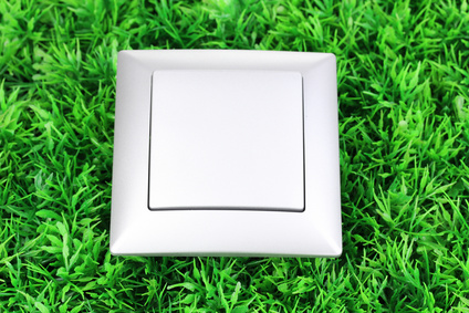 Modern light switch on green grass