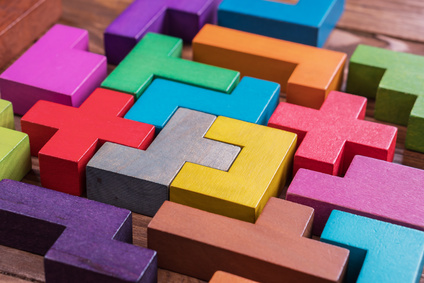 The concept of logical thinking. Geometric shapes on a wooden background.