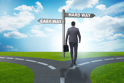 Businessman choosing between hard and easy way
