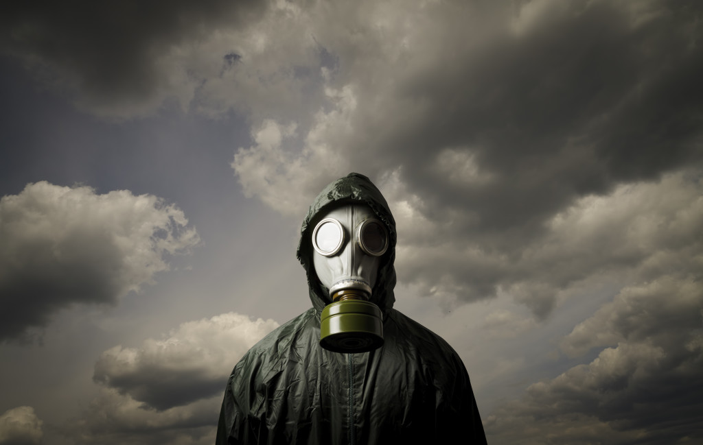 Man wearing a gas mask on his face