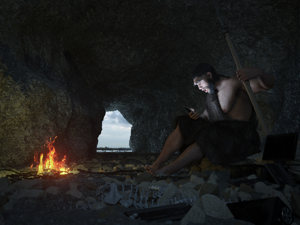 primitive man siting in the cave with smartphone concept illustration